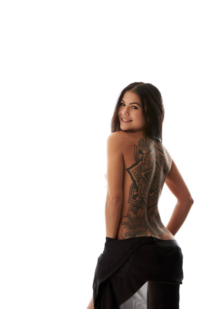 Boudoir- woman in black pants with back tattoo