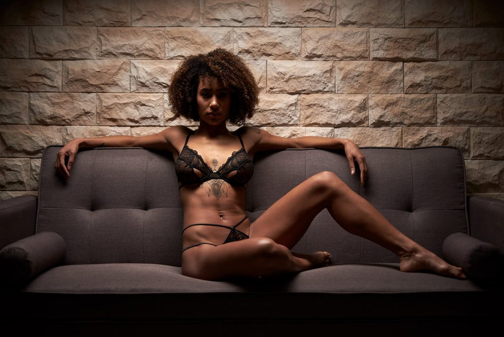 Boudoir- woman in lingerie sitting on couch