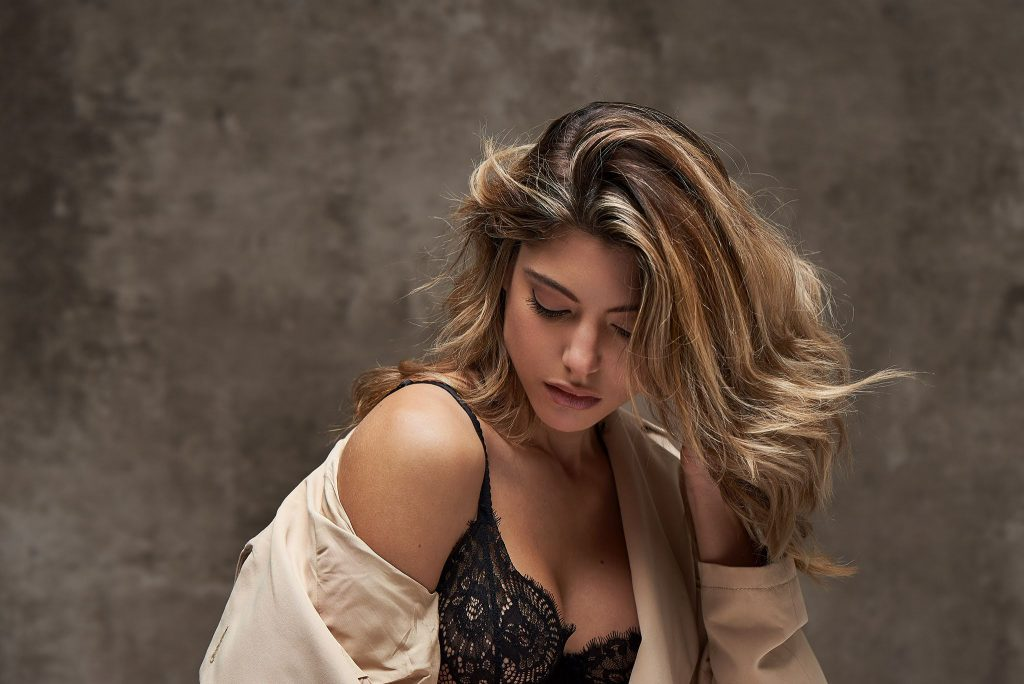 Boudoir- woman in trench coat and black bra