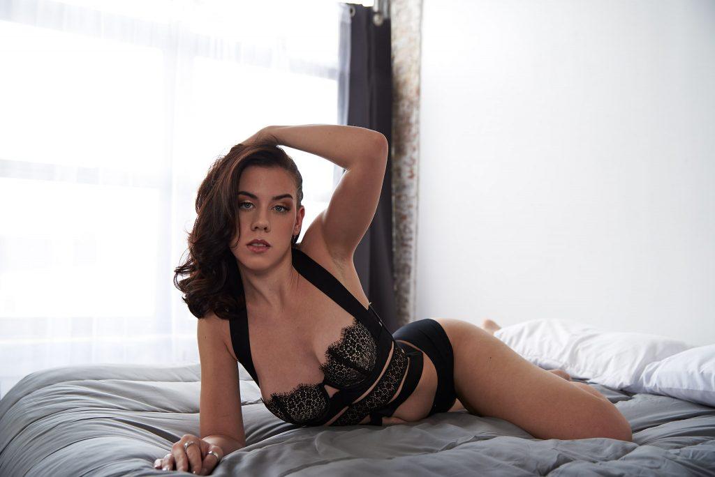 Boudoir woman in black lingerie on bed