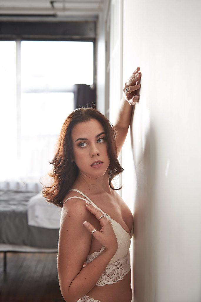 Boudoir - woman against white wall