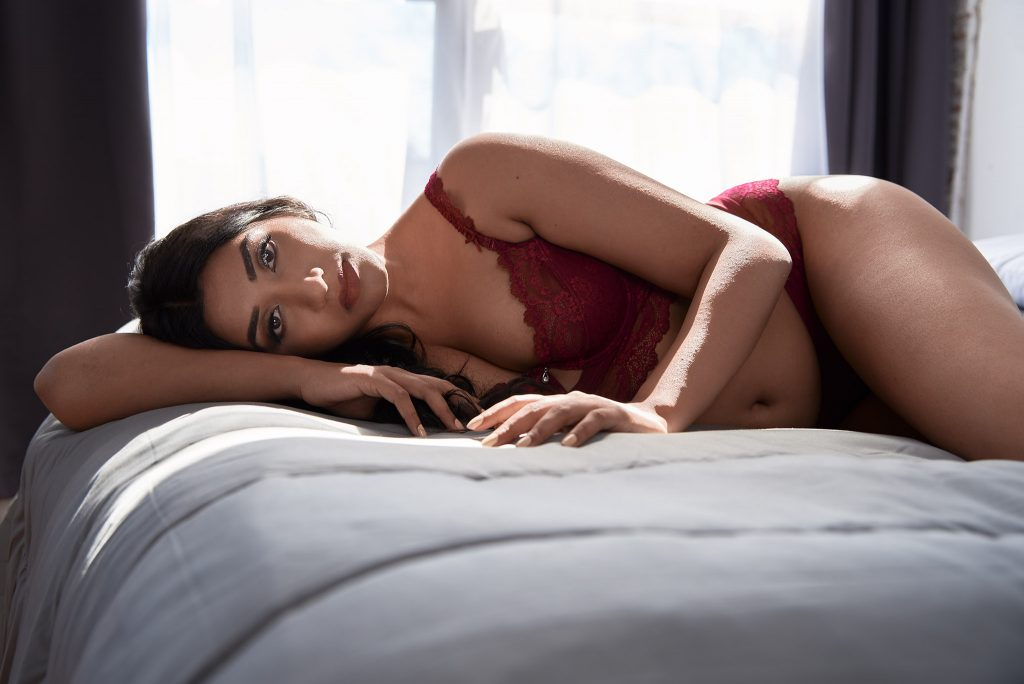 Boudoir- woman in red laying on bed